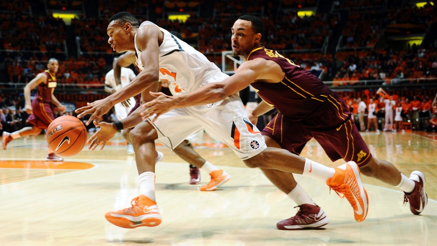 Illinois guard Joseph Bertrand (2) drives under pressure from Minnesota guard Joe Coleman (11) during their NCAA college basketball game, Wednesday, Jan. 9, 2013, in Champaign, Ill. (AP Photo/The News-Gazette, Darrell Hoemann)  MANDATORY CREDIT