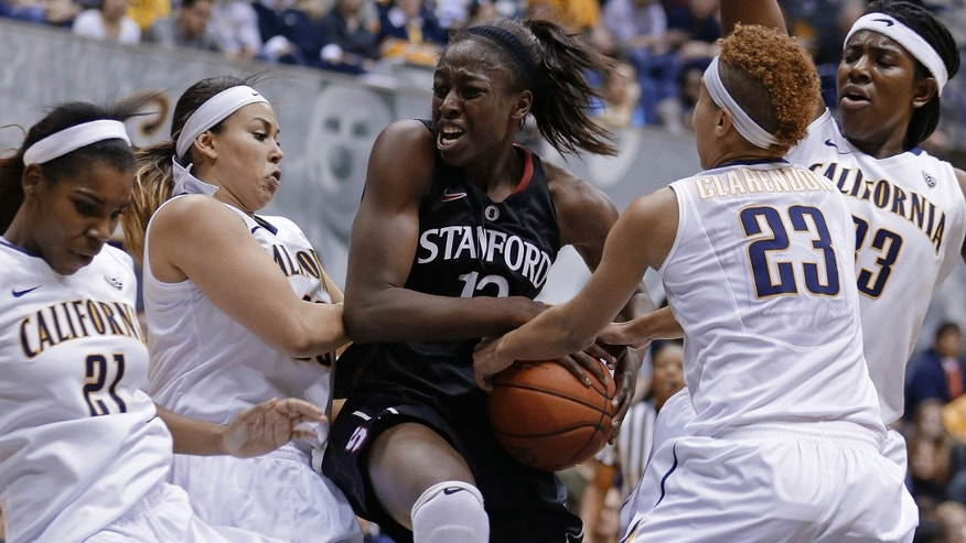 Stanford's Chiney Ogwumike, center, struggles to keep the ball from California's Layshia Clarendon (23) in the first half of an NCAA college basketball game Tuesday, Jan. 8, 2013, in Berkeley, Calif. (AP Photo/Ben Margot)