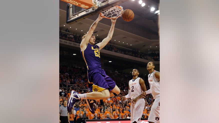 LSU center Andrew Del Piero (55) dunks the ball over Auburn forward Allen Payne (2) and center Asauhn Dixon-Tatum (0) in the first half of an NCAA college basketball game at Auburn Arena in Auburn, Ala., Wednesday, Jan. 9, 2013. (AP Photo/Dave Martin)