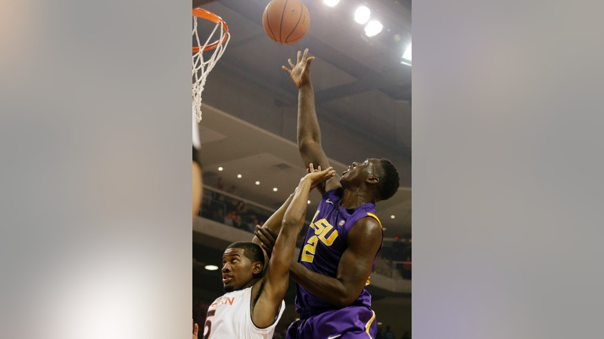 LSU forward Johnny O'Bryant III (2) shoots over the interesting defense of Auburn forward Shaquille Johnson (5) in the first half of an NCAA college basketball game at Auburn Arena in Auburn, Ala., Wednesday, Jan. 9, 2013. (AP Photo/Dave Martin)