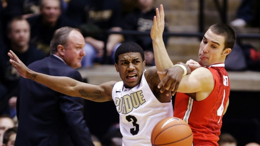 Ohio State guard Aaron Craft, right, tangles with Purdue guard Ronnie Johnson as he makes a steal in the first half of an NCAA college basketball game in West Lafayette, Ind., Tuesday, Jan. 8, 2013. (AP Photo/Michael Conroy)