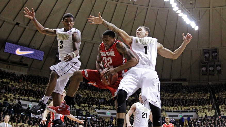 Ohio State guard Lenzelle Smith Jr., (32) grabs a rebound between Purdue guards Anthony Johnson (1) and Ronnie Johnson in the first half of an NCAA college basketball game in West Lafayette, Ind., Tuesday, Jan. 8, 2013. (AP Photo/Michael Conroy)