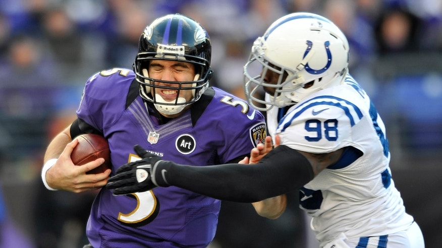 Baltimore Ravens quarterback Joe Flacco (5) is sacked by Indianapolis Colts outside linebacker Robert Mathis (98) during the second half of an NFL wild card playoff football game Sunday, Jan. 6, 2013, in Baltimore. (AP Photo/Gail Burton)