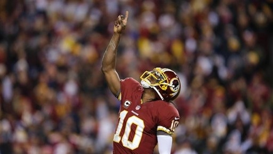 Dec. 30, 2012: Washington Redskins quarterback Robert Griffin III celebrates a touchdown during the first half of an NFL football game against the Dallas Cowboys. (AP)