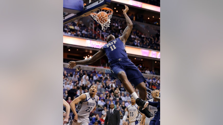 Pittsburgh forward Dante Taylor dunks as Georgetown forward Otto Porter Jr. (22) watches during the first half of an NCAA college basketball game, Tuesday, Jan. 8, 2013, in Washington. (AP Photo/Alex Brandon)