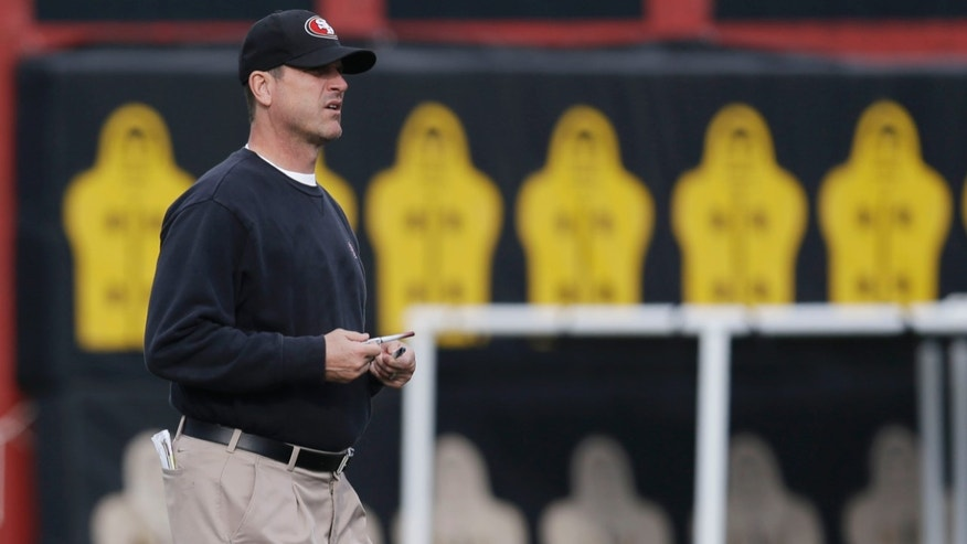 San Francisco 49ers head coach Jim Harbaugh watches his team during NFL football practice in Santa Clara, Calif., Wednesday, Jan. 9, 2013. The 49ers host the Green Bay Packers in an NFC divisional playoff game on Saturday. (AP Photo/Marcio Jose Sanchez)