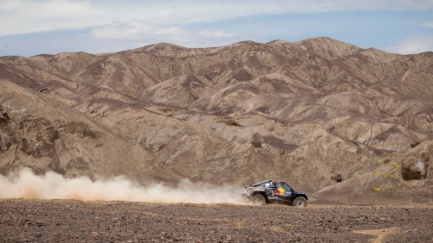 Driver Nasser Al-Attiyah of Qatar and co-driver Lucas Cruz of Spain compete in the 6th stage of the 2013 Dakar Rally from Arica to Calama, Chile, Thursday, Jan. 10, 2013. The race finishes in Santiago, Chile, on Jan. 20. (AP Photo/Victor R. Caivano)