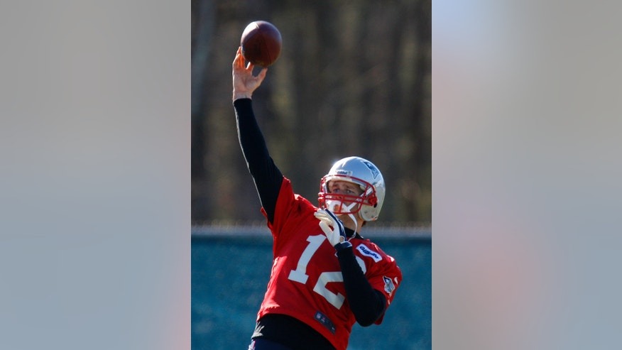 New England Patriots quarterback Tom Brady throws a pass during NFL football practice at the team's facility in Foxborough, Mass., Thursday, Jan. 10, 2013. The Patriots host the Houston Texans in an AFC divisional playoff game on Sunday. (AP Photo/Stephan Savoia)
