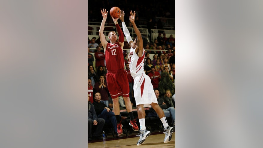 Washington State 's Brock Motum (12) shoots over Stanford 's Josh Huestis during the first half of an NCAA college basketball game in Stanford, Calif., Wednesday, Jan. 9,  2013. (AP Photo/Marcio Jose Sanchez)