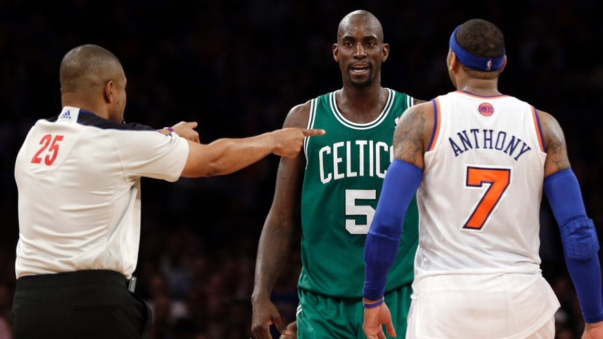 "In this photo taken Monday, Jan. 7, 2013, referee Tony Brothers, left, issues technical fouls to New York Knicks' Carmelo Anthony and Boston Celtics' Kevin Garnett during the second half of an NBA basketball game at Madison Square Garden in New York. The All-Star forwards exchanged words during the game and Anthony clearly was affected. He said Tuesday he lost his cool after Garnett said things to him that he feels shouldn't be said to ""another man.""  (AP Photo/Kathy Willens)"