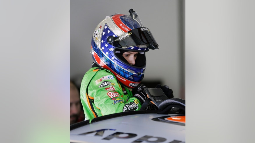 Driver Danica Patrick climbs out of her car in her garage during NASCAR auto race testing at Daytona International Speedway, Thursday, Jan. 10, 2013, in Daytona Beach, Fla. (AP Photo/John Raoux)