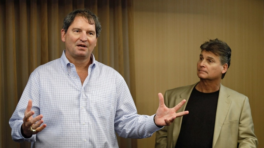 Former Cleveland Browns quarterback Bernie Kosar, left, speaks at a news conference with Dr. Rick Sponaugle, in Middleburg Heights, Ohio Thursday, Jan. 10, 2013. Kosar, who has suffered for years with headaches, insomnia and slurred speech as the result of years of punishing hits in the NFL, has found some relief after undergoing treatment by Sponaugle - something he feels can help hundreds of ex-players dealing with the effects of playing pro ball. (AP Photo/Mark Duncan)