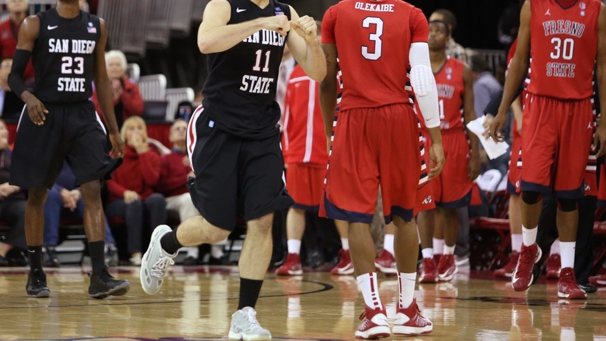 San Diego State's James Rahon celebrates a close win over Fresno State in the second half of an NCAA college basketball game Wednesday, Jan. 9, 2013 in Fresno, Calif.