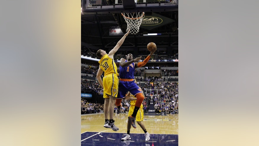 New York Knicks' Amare Stoudemire (1) shoots against Indiana Pacers' Tyler Hansbrough (50) during the first half of an NBA basketball game, Thursday, Jan. 10, 2013, in Indianapolis. (AP Photo/Darron Cummings)