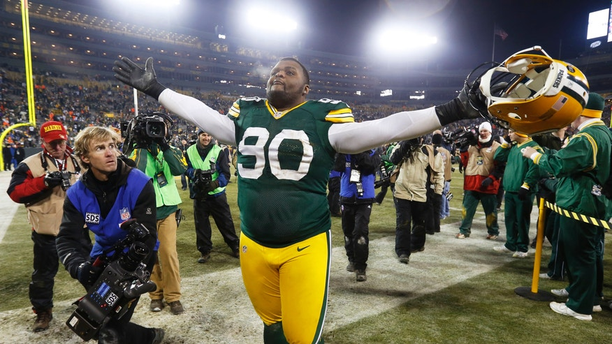 Green Bay Packers nose tackle B.J. Raji (90) celebrates after an NFL wild card playoff football game against the Minnesota Vikings Saturday, Jan. 5, 2013, in Green Bay, Wis. Packers won 24-10. (AP Photo/Mike Roemer)