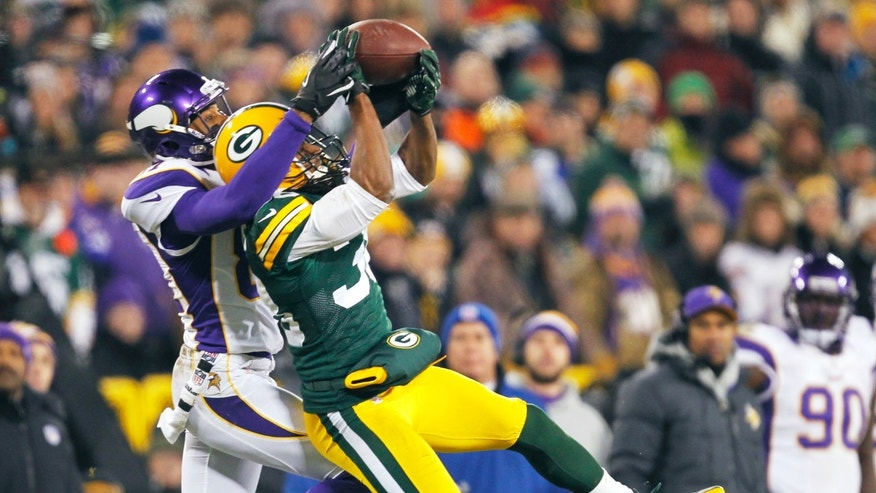 Green Bay Packers cornerback Tramon Williams (38) breaks up a pass intended for Minnesota Vikings wide receiver Jerome Simpson, left, during the second half of an NFL wild card playoff football game Saturday, Jan. 5, 2013, in Green Bay, Wis.  Packers won 24-10. (AP Photo/Mike Roemer)