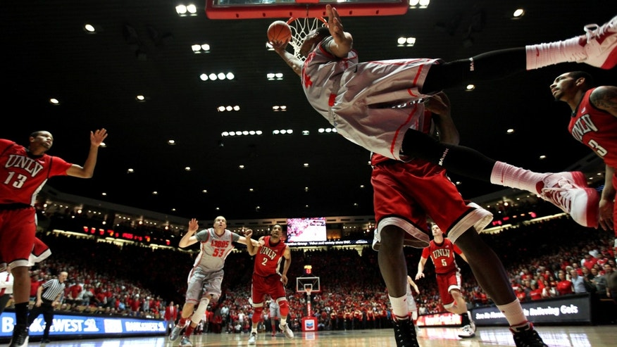 New Mexico's Chad Adams, front, attempts to score against UNLV's Anthony Bennett during the first half of an NCAA college basketball game on Wednesday, Jan 9, 2013, in Albuquerque, NM. From left, UNLV's Bryce Dejean-Jones, New Mexico's Alex Kirk, UNLV's Khem Birch (2), Katlin Reinhardt (4) and Anthony Marshall (3).  (AP Photo/Eric Draper)