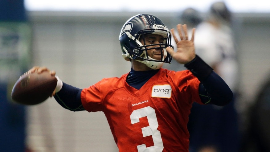 Seattle Seahawks quarterback Russell Wilson throws a pass during NFL football practice, Wednesday, Jan. 9, 2013, in Renton, Wash. The Seahawks play the Atlanta Falcons on Sunday in an NFC divisional playoff game in Atlanta. (AP Photo/Ted S. Warren)