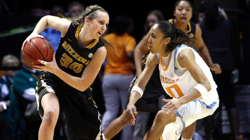 Missouri's Morgan Eye (30) keeps the ball from Tennessee guard Meighan Simmons (10) during the first half of an NCAA women's college basketball game, Thursday, Jan. 10, 2013, in Knoxville, Tenn. (AP Photo/Wade Payne)