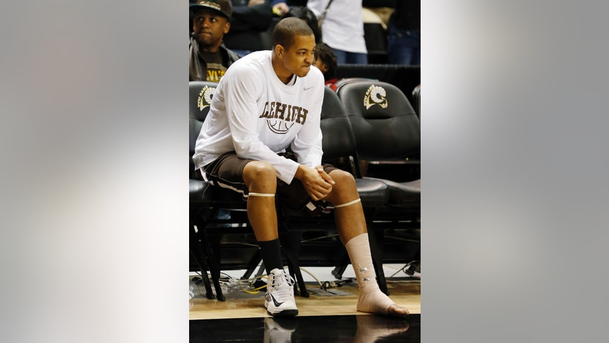 FILE - In this Jan. 5, 2012, file photo, Lehigh's C.J. McCollum sits on the bench midway through the second half after being injured   during the first half of an NCAA college basketball game against  VCU in Richmond, Va. The star guard who helped the Mountain Hawks pull off a stunning NCAA tournament upset of Duke last year could miss the rest of this season with a left foot injury. (AP Photo/The Richmond Times-Dispatch, Joe Mahoney, File)