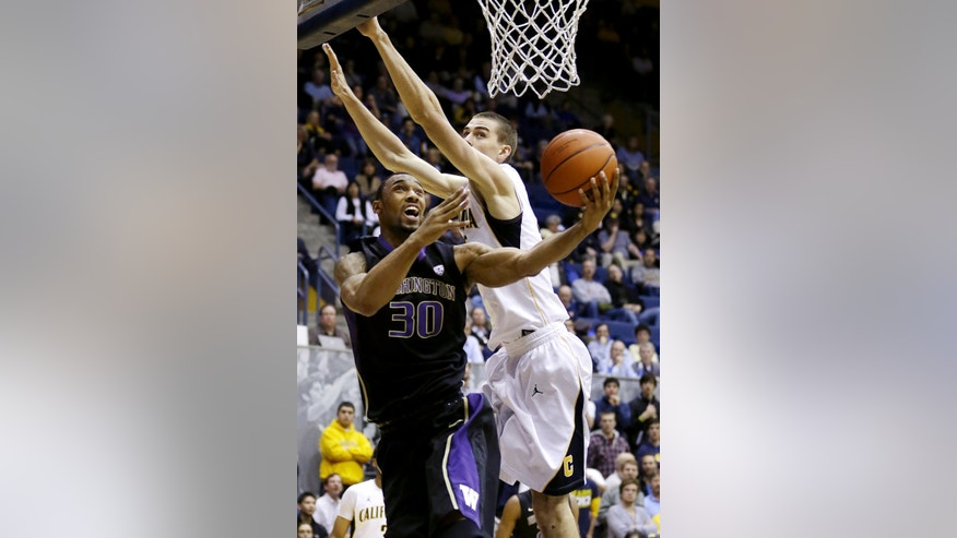 Washington forward Desmond Simmons (30) shoots against California forward David Kravish (45) during the first half of an NCAA college basketball game in Berkeley, Calif., Wednesday, Jan. 9, 2013. (AP Photo/Jeff Chiu)