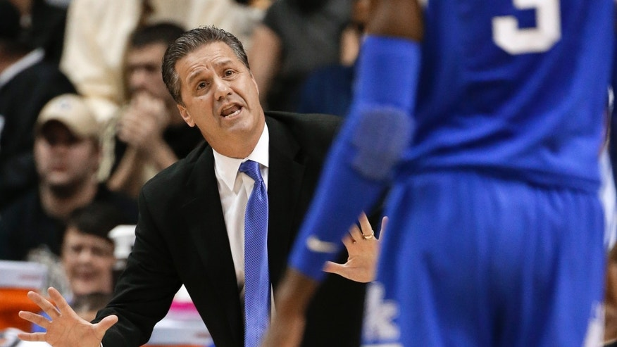 Kentucky head coach John Calipari directs forward Nerlens Noel, right, in the first half of an NCAA college basketball game against Vanderbilt on Thursday, Jan. 10, 2013, in Nashville, Tenn. (AP Photo/Mark Humphrey)