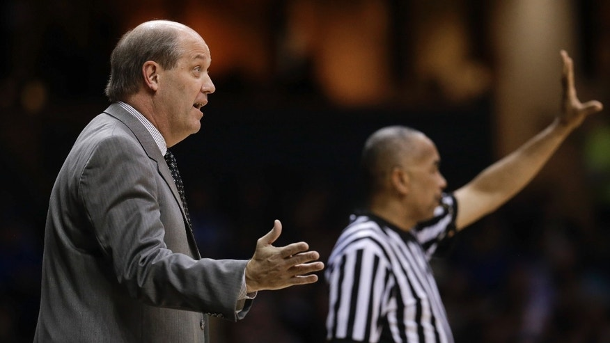 Vanderbilt head coach Kevin Stallings, left, talks to his players in the first half of an NCAA college basketball game against Kentucky on Thursday, Jan. 10, 2013, in Nashville, Tenn. (AP Photo/Mark Humphrey)