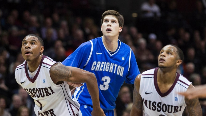 Creighton forward Doug McDermott (3) is blocked out by Missouri State's Keith Pickens (1) and Anthony Downing (0) during the first half of an NCAA college basketball game Friday, Jan. 11, 2013, in Springfield, Mo. Creighton beat Missouri State 74-52. (AP Photo/David Welker)