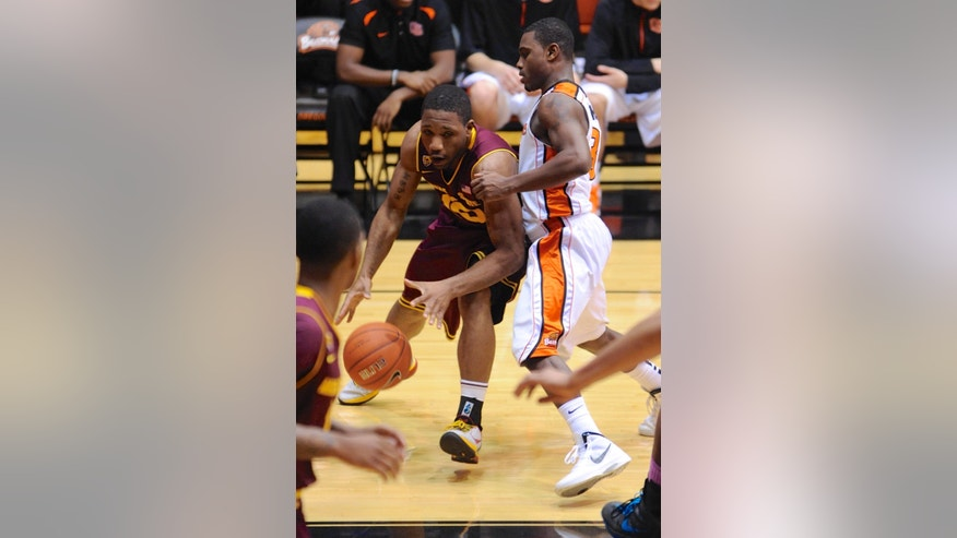 Arizona State's Evan Gordon (10) drives against Oregon State's Ahmad Starks (3) during the first half of an NCAA college basketball game in Corvallis, Ore., Thursday Jan. 10, 2013. (AP Photo/Greg Wahl-Stephens)