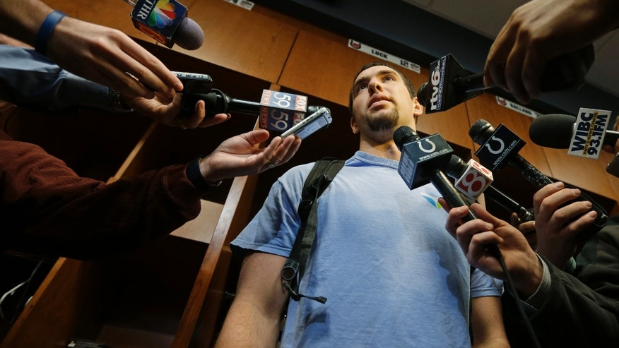 Indianapolis Colts quarterback Andrew Luck responds to a question from the media while standing at his locker at the Colts complex Monday, Jan. 7, 2013, in Indianapolis. The Colts were defeated by the Baltimore Ravens, 24-9, in a NFL football wild card playoff game on Sunday. (AP Photo/Darron Cummings)