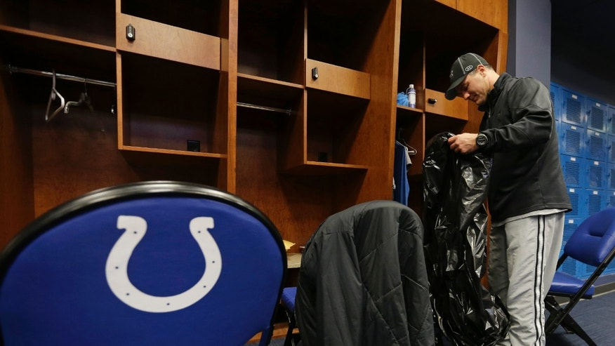 Indianapolis Colts' Adam Vinatieri clears out his locker at the Colts complex Monday, Jan. 7, 2013, in Indianapolis. The Colts were defeated by the Baltimore Ravens, 24-9, in a NFL football wild card playoff game on Sunday. (AP Photo/Darron Cummings)