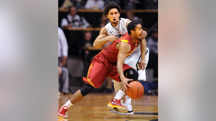 Southern California's Jio Fontan, front, tries to drive past Colorado's Askia Booker during the first half of their NCAA college basketball game, Thursday, Jan. 10, 2013, in Boulder, Colo. (AP Photo/The Daily Camera, Cliff Grassmick) NO SALES; MAGS OUT; TV OUT