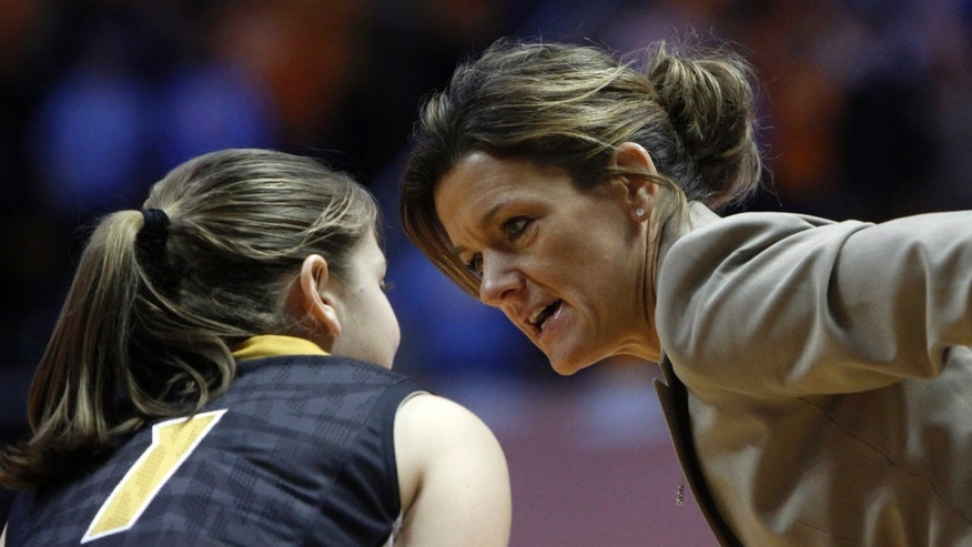 Missouri head coach Robin Pingeton, right, talks with Lianna Doty (1) during the first half of an NCAA women's college basketball game against Tennessee, Thursday, Jan. 10, 2013, in Knoxville, Tenn. Tennessee won 84-39. (AP Photo/Wade Payne)