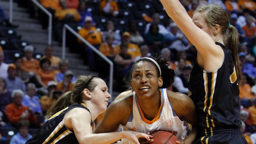 Tennessee forward Bashaara Graves, center, goes for a shot as she's defended by Missouri's Bree Fowler, left, and Morgan Eye during the second half of an NCAA women's college basketball game, Thursday, Jan. 10, 2013, in Knoxville, Tenn. Tennessee won 84-39. (AP Photo/Wade Payne)