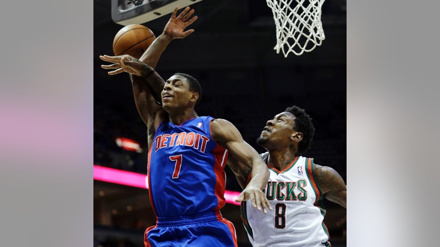 Milwaukee Bucks center Larry Sanders, right, blocks a shot by Detroit Pistons point guard Brandon Knight during the first half of an NBA basketball game Friday, Jan. 11, 2013, in Milwaukee. (AP Photo/Morry Gash)