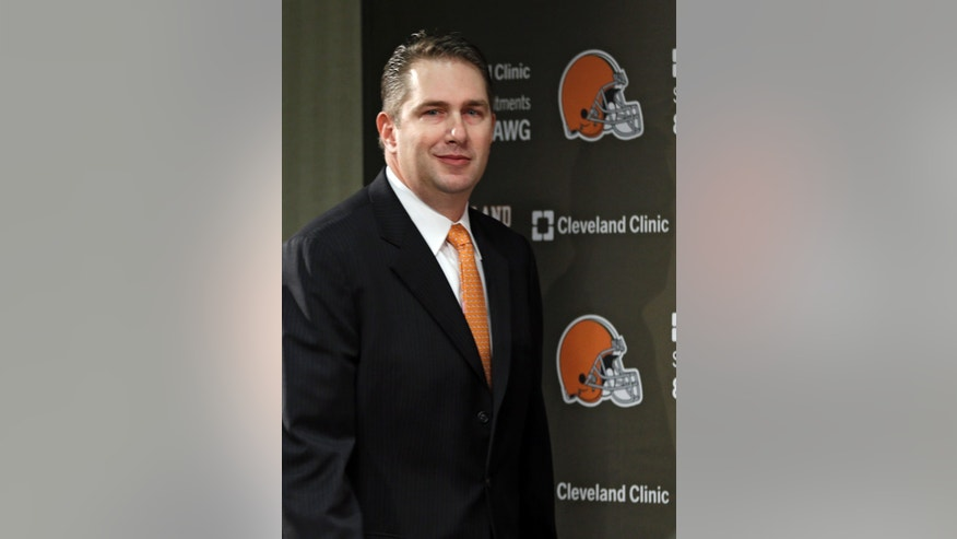 Rob Chudzinski walks to the podium to be introduced as the new head coach of the Cleveland Browns at the NFL football team's practice facility in Berea, Ohio Friday, Jan. 11, 2013. (AP Photo/Mark Duncan)