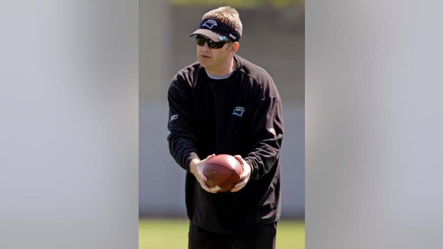 FILE - In this June 7, 2012, file photo, Carolina Panthers offensive coordinator Rob Chudzinski instructs players during an NFL football practice in Charlotte, N.C. A person familiar with the decision said Thursday, Jan. 10, 2013, that the Cleveland Browns have hired Chudzinski as their new coach. (AP Photo/Chuck Burton, File)