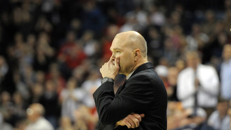 Saint Mary's head coach Randy Bennett appears concerned during the game against Gonzaga, in the first half of an NCAA college basketball game, Thursday, Jan. 10, 2013, in Spokane, Wash. (AP Photo/Jed Conklin)