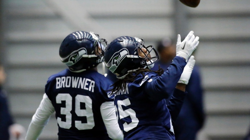 Seattle Seahawks cornerbacks Brandon Browner (39) and Richard Sherman, right, take part in a defensive drill during NFL football practice, Wednesday, Jan. 9, 2013, in Renton, Wash. he Seahawks play the Atlanta Falcons on Sunday in an NFC divisional playoff game in Atlanta. (AP Photo/Ted S. Warren)