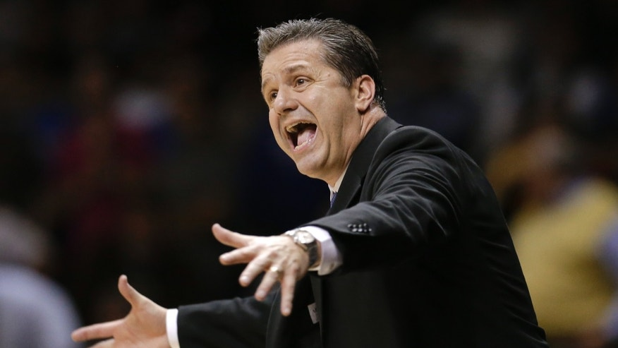 Kentucky head coach John Calipari yells to his players in the second half of an NCAA college basketball game against Vanderbilt on Thursday, Jan. 10, 2013, in Nashville, Tenn. Kentucky won 60-58. (AP Photo/Mark Humphrey)