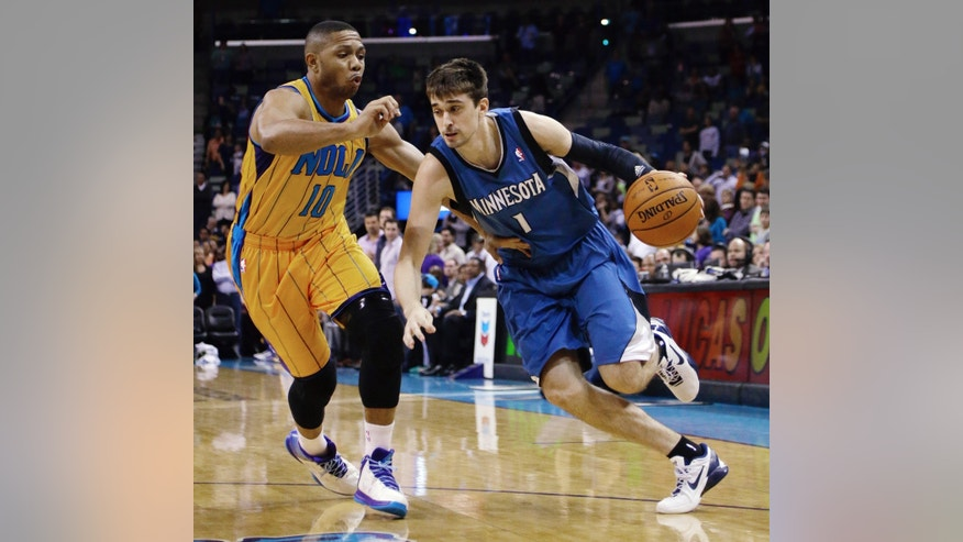 Minnesota Timberwolves guard Alexey Shved (1) drives past New Orleans Hornets guard Eric Gordon (10) in the first half of an NBA basketball game  in New Orleans, Friday, Jan. 11, 2013. (AP Photo/Bill Haber)