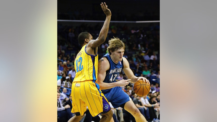 Minnesota Timberwolves forward Andrei Kirilenko (47) drives past New Orleans Hornets guard Donald Sloan (12) in the first half of an NBA basketball game  in New Orleans, Friday, Jan. 11, 2013. (AP Photo/Bill Haber)