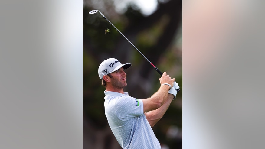 Dustin Johnson follows his shot off the first fairway during the first round of the Sony Open golf tournament on Thursday, Jan. 10, 2013, in Honolulu. (AP Photo/Marco Garcia)