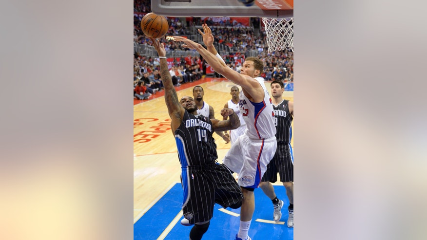 Orlando Magic guard Jameer Nelson, left, goes up for a shot as Los Angeles Clippers  forward Blake Griffin defends during the first half of their NBA basketball game, Saturday, Jan. 12, 2013, in Los Angeles. (AP Photo/Mark J. Terrill)