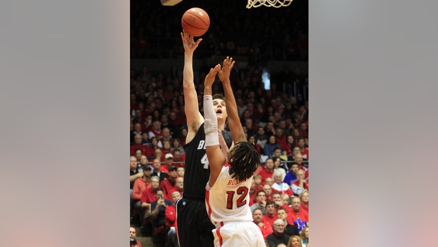 Butler's Andrew Smith shoots over Dayton's Jalen Robinson (12) during the first half of an NCAA college basketball game, Saturday, Jan. 12, 2013, in Dayton, Ohio. (AP Photo/Skip Peterson)