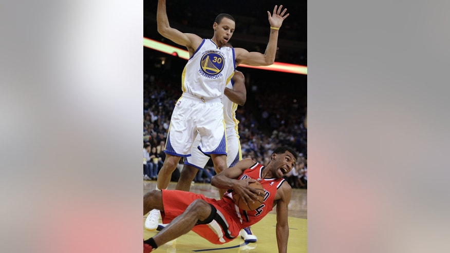 Portland Trail Blazers' Nolan Smith (4) slides in front of Golden State Warriors' Stephen Curry during the first half of an NBA basketball game Friday, Jan. 11, 2013, in Oakland, Calif. (AP Photo/Ben Margot)