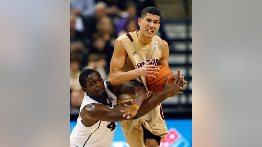 Boston College's Lonnie Jackson, right, and Wake Forest's Arnaud William Adala Moto, left, collide during the second half of an NCAA college basketball game in Winston-Salem, N.C., Saturday, Jan. 12, 2013. Wake Forest won 75-72. (AP Photo/Chuck Burton)