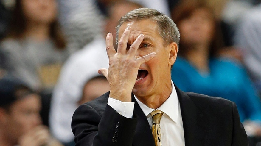 Wake Forest head coach Jeff Bzdelik directs his team against Boston College during the first half of an NCAA college basketball game in Winston-Salem, N.C., Saturday, Jan. 12, 2013. (AP Photo/Chuck Burton)