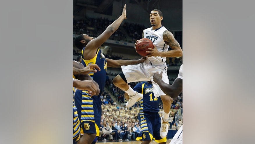Pittsburgh's Cameron Wright, right, looks to shoot as Marquette's Davante Gardner defends during the first half of an NCAA college basketball game,  Saturday, Jan. 12, 2013, in Pittsburgh. (AP Photo/Keith Srakocic)