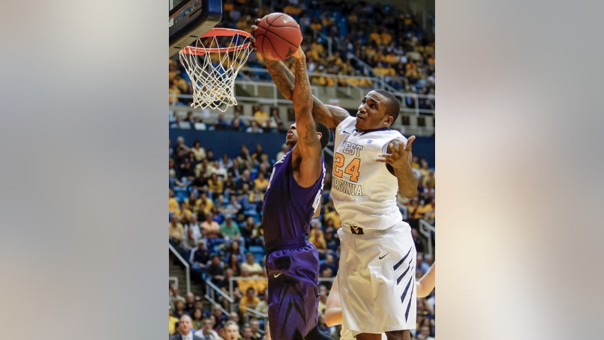 West Virginia's Aaric Murray (24) fights for a rebound over Kansas State's Rodney McGruder, left, during the first half of an NCAA college basketball game at WVU Coliseum in Morgantown, W.Va., on Saturday, Jan. 12, 2013. (AP Photo/David Smith)